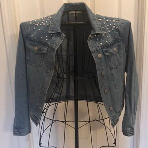 Tailored denim jacket with pearl embellishments.
